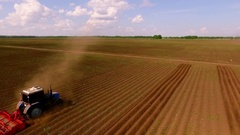 Bird view two tractor on ploughed field 17.23.37 Stock Footage