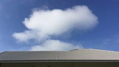 Time lapse beautiful clouds move fast over the roof of the house. Stock Footage