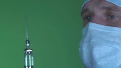 Doctor checks the contents of the injection site Stock Footage
