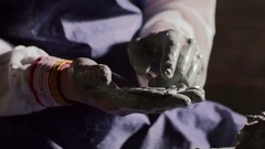 Potter's hands making ornament Stock Footage