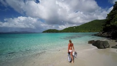Aerial view of a bikini woman walking out to snorkel, st john Stock Footage