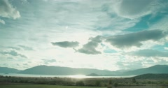 Mountain valley with a lake in the fall with a beautiful sunset through clouds Stock Footage