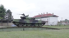 Tank crossing a armoured vehicle-launched bridge ,accelerated footage Stock Footage