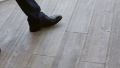 Close up of businessmen legs in black shoes and trousers walking on the floor Stock Footage