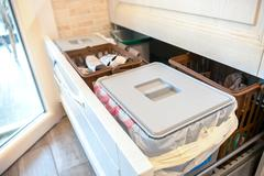 Waste sorting drawer recycling kitchen home chores Stock Photos