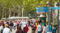 Tourists Walking La Rambla in Barcelona Spain Stock Footage
