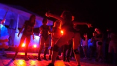 Twitching legs and booty dancing girl close up on stage in club Stock Footage