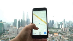 A Google Maps user using the app in his smartphone Stock Footage