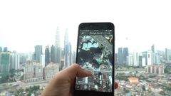 A Google Earth user using the app in his smartphone Stock Footage