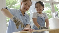 4K : Asian woman teaching her daughter assembling new DIY furniture at home Stock Footage