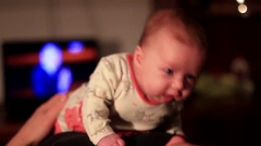 Baby lying on dad in front of the camera Stock Footage