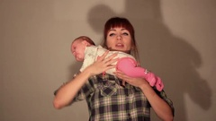 Mother raises the baby up Stock Footage