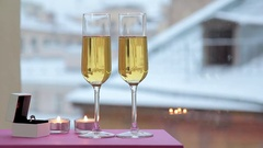 Still life with a ring in a box with glasses of champagne Stock Footage