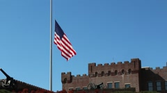Canon in Foreground of US Flag at Half Mast Stock Footage