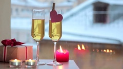 Sparkling wine in two glasses and gift for Valentine's Day Stock Footage