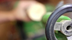 Woodturners using a rotating clamp to turn the wood Stock Footage