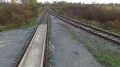 Rails on asphalt drone shot Stock Footage
