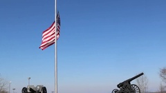 US Flag at Half Mast with Military Canons at Base Stock Footage