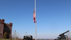 US Flag at Half Mast with Canons at Base Stock Footage