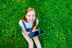 Beautiful smiling red-haired young woman Stock Photos