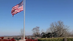 US Flag Waving over Hilltop Lined with Canons Stock Footage