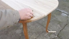 Carpenter is covering table by lacquer Stock Footage