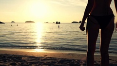 Sexy woman walking on beach and admire sunset, super slow motion 120fps Stock Footage
