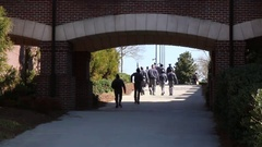 Cadets/Students Walking Through Tunnel to Parade Ground Stock Footage