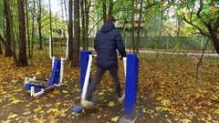 Street workout sessions on simulators in the autumn forest Stock Footage