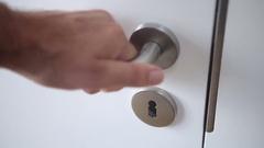 Closeup of man closing a door and locks it indoors Stock Footage