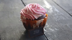 Cupcake, and text Stop - unhealthy food or diet idea Stock Footage