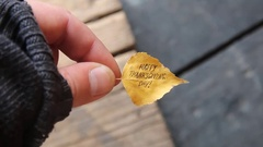 Autumn leaf with text Happy Thanksgiving day Stock Footage
