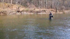 Fisherman pulls caught grayling Stock Footage