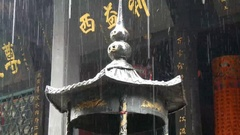 China Top of Taoist shrine for burning offerings in rain Stock Footage