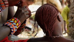 Young Masai combing their hair Stock Footage