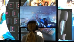Teenage girl enthusiastically playing a computer shooter. Stock Footage