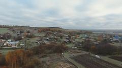 Flight over a sleeping village Stock Footage