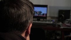 Man watches video on the computer Stock Footage