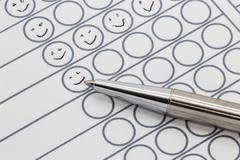 Evaluation paper with hand drawn smileys Stock Photos