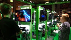 Many teens are testing new games by Xbox using a gamepads. Stock Footage