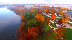 Scenic riverside small town with foggy Autumn sunrise, Wrightstown, Wisconsin. Stock Footage