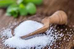 Old wooden table with Stevia Granules (selective focus) Stock Photos