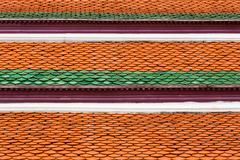 Orange and green roof tiles architecture detail Stock Photos