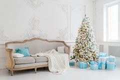 Stylish Christmas interior with an elegant sofa. Comfort home. Presents gifts Stock Photos