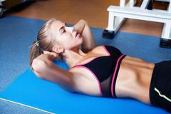 Girl exercising abs Stock Photos
