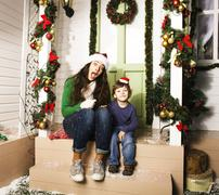 Happy smiling family on Christmas at house with gifts, young mot Stock Photos