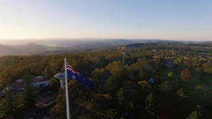 4K Aerial Of Toowoomba Orbiting Australian Flag At Picnic Point Stock Footage