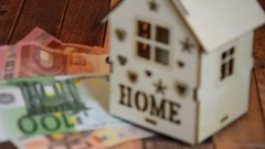 Model of wooden house placed on money, Stock Footage
