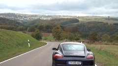 Steady shot of Porsche driving in the nature. Stock Footage