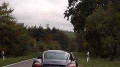 Porsche driving on the nature. Stock Footage